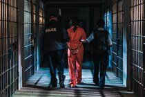 Photo 'Prisoner Led Away' by Shopify Partners from Burst